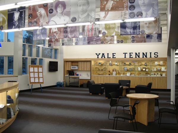 Trophy cases and banners in tennis center lobby